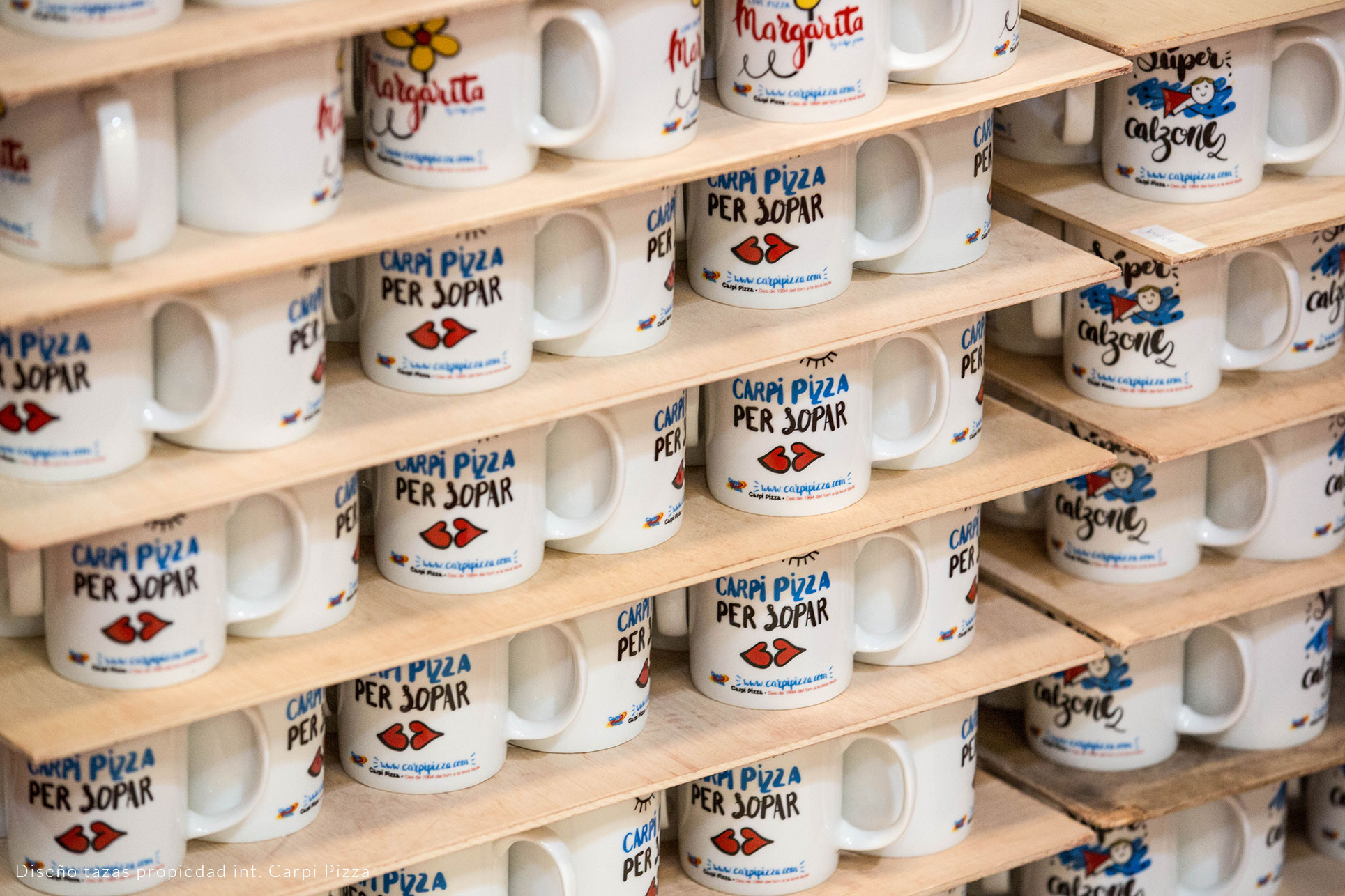Mugs with company logo prepared to be fired